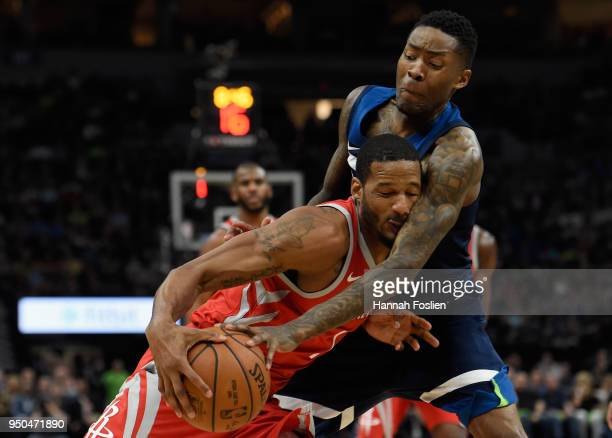 Jamal Crawford of the Minnesota Timberwolves fouls Trevor Ariza of the Houston Rockets during the second quarter in Game Four of Round One of the...
