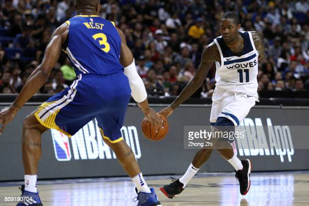 Jamal Crawford of the Minnesota Timberwolves in action against David West of the Golden State Warriors during the game between the Minnesota...