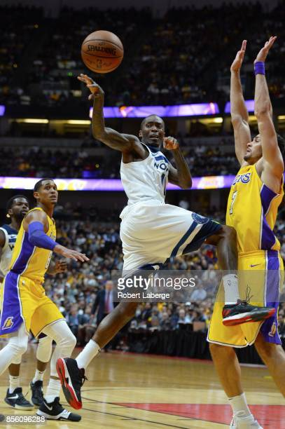 Jamal Crawford of the Minnesota Timberwolves makes a pass as Larry Nance Jr #7 of the Los Angeles Lakers tries to block him on September 30 2017 at...