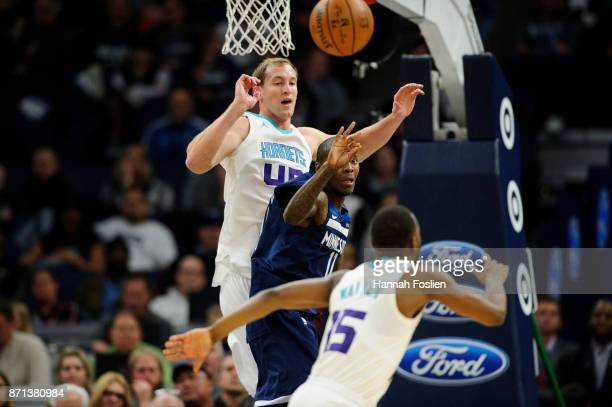 Jamal Crawford of the Minnesota Timberwolves passes the ball away from Cody Zeller and Kemba Walker of the Charlotte Hornets during the game on...