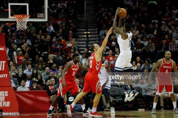 Jamal Crawford of the Minnesota Timberwolves takes a jump shot defended by Ryan Anderson of the Houston Rockets in the first half at Toyota Center on...