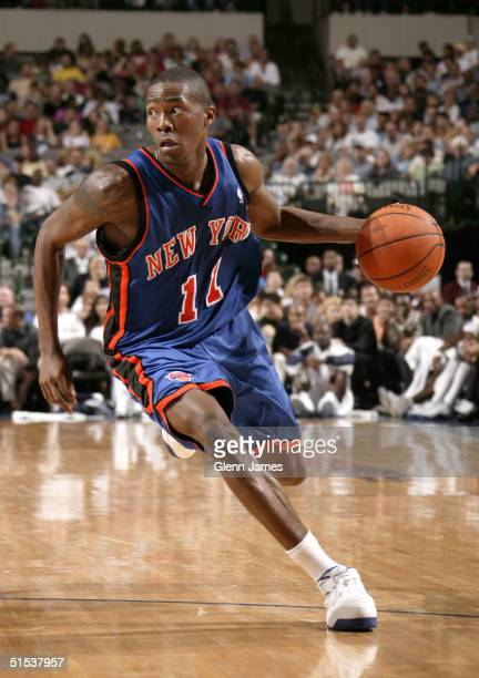 Jamal Crawford of the New York Knicks drives to the basket against the Dallas Mavericks on October 21 2004 at the American Airlines Center in Dallas...