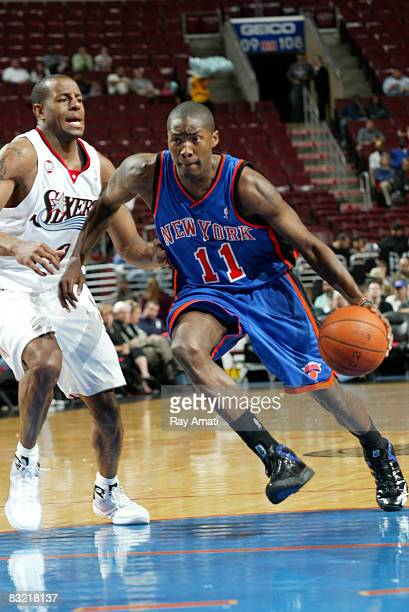 Jamal Crawford of the New York Knicks drives to the basket against Andre Iguodala of the Philadelphia 76ers on October 10 2008 at the Wachovia Center...