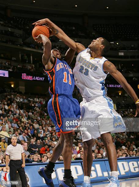 Jamal Crawford of the New York Knicks is blocked by Marcus Camby of the Denver Nuggets on November 8 2006 at the Pepsi Center in Denver Colorado NOTE...