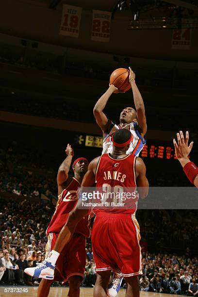 Jamal Crawford of the New York Knicks shoots over LeBron James of the Cleveland Cavaliers during the game at the Madison Square Garden on April 5,...