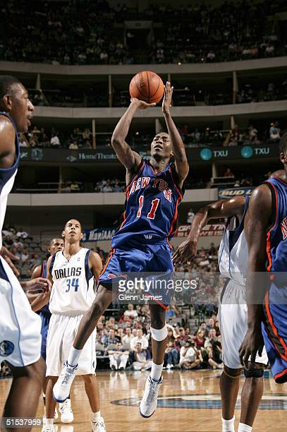 Jamal Crawford of the New York Knicks shoots the ball against the Dallas Mavericks on October 21 2004 at the American Airlines Center in Dallas Texas...