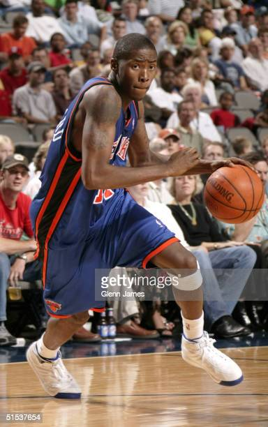 Jamal Crawford of the New York Nicks drives to the basket against the Dallas Mavericks at the American Airlines Center on October 21 2004 in Dallas...