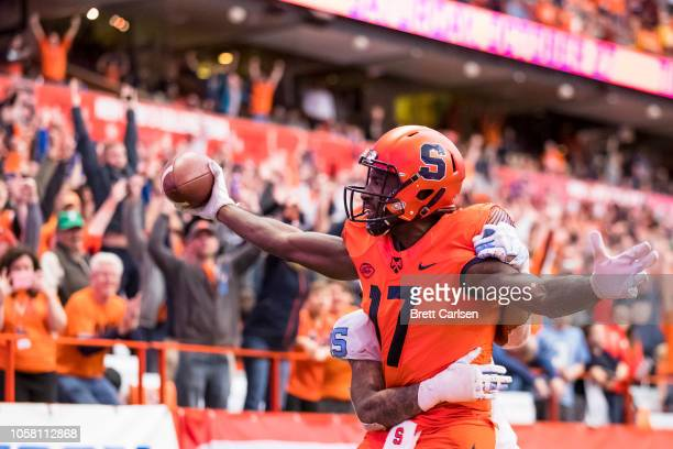 Jamal Custis of the Syracuse Orange makes a touchdown reception during the first overtime as Greg Ross of the North Carolina Tar Heels defends at the...