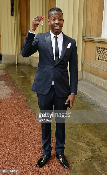 Jamal Edwards holds his Member of the British Empire after it was awarded to him by the Prince of Wales at an Investiture Ceremony at Buckingham...