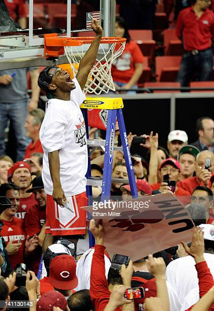 Jamal Fenton of the New Mexico Lobos cuts down the net after defeating the San Diego State Aztecs 6859 to win the championship game of the Conoco...
