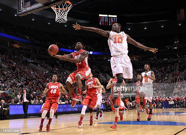 Jamal Fenton of the New Mexico Lobos goes up for a shot against Gorgui Dieng of the Louisville Cardinals in the second half during the third round of...