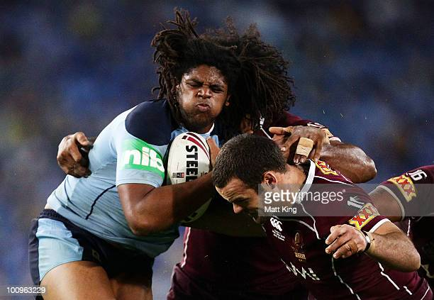 Jamal Idris of the Blues takes on the Maroons defence during game one of the ARL State of Origin series between the New South Wales Blues and the...