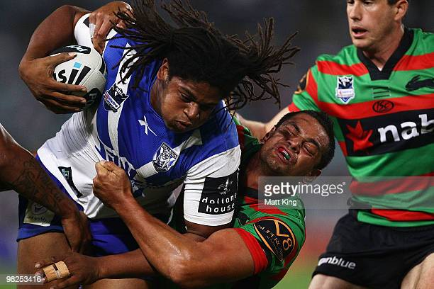 Jamal Idris of the Bulldogs is tackled by John Sutton of the Rabbitohs during the round four NRL match between the South Sydney Rabbitohs and the...
