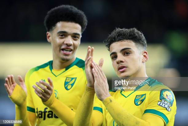 Jamal Lewis and Max Aarons acknowledge the fans during the Premier League match between Norwich City and Leicester City at Carrow Road on February...