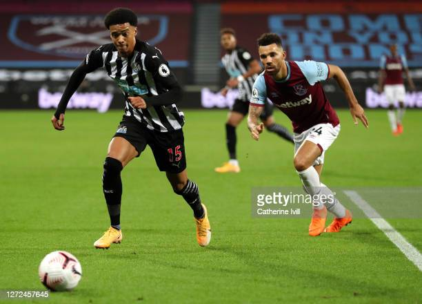 Jamal Lewis of Newcastle United and Ryan Fredericks of West Ham United during the Premier League match between West Ham United and Newcastle United...