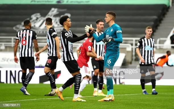 Jamal Lewis of Newcastle United congratulates Karl Darlow of Newcastle United after he saved a penalty during the Premier League match between...