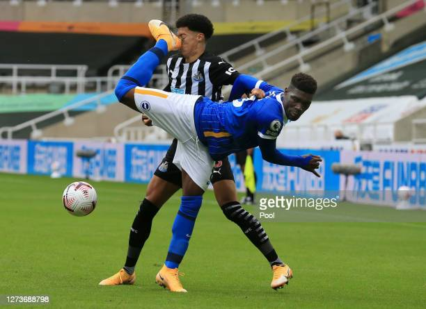 Jamal Lewis of Newcastle United is kicked in the face by Yves Bissouma of Brighton and Hove Albion during the Premier League match between Newcastle...