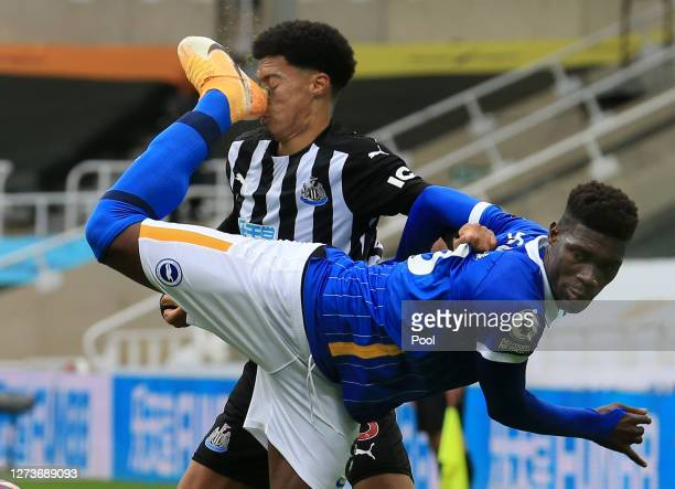 Jamal Lewis of Newcastle United is kicked in the face by Yves Bissouma of Brighton and Hove Albion, leading to a red card for Yves Bissouma of...