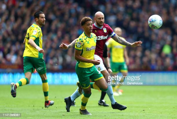 Jamal Lewis of Norwich City and Alan Hutton of Aston Villa in action during the Sky Bet Championship match between Aston Villa and Norwich City at...