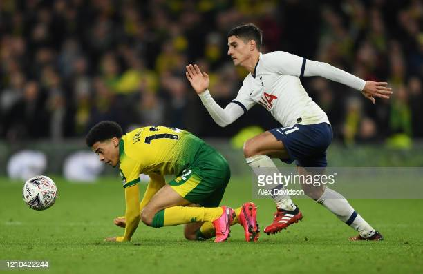 Jamal Lewis of Norwich City and Erik Lamela of Tottenham Hotspur in action during the FA Cup Fifth Round match between Tottenham Hotspur and Norwich...
