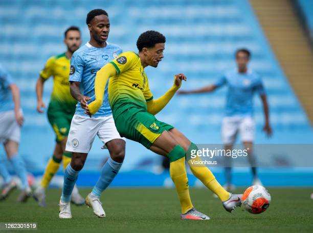 Jamal Lewis of Norwich City and Raheem Sterling of Manchester City in action during the Premier League match between Manchester City and Norwich City...