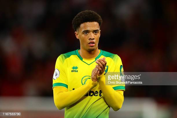 Jamal Lewis of Norwich City applauds the supporters following the Premier League match between Liverpool FC and Norwich City at Anfield on August 09,...