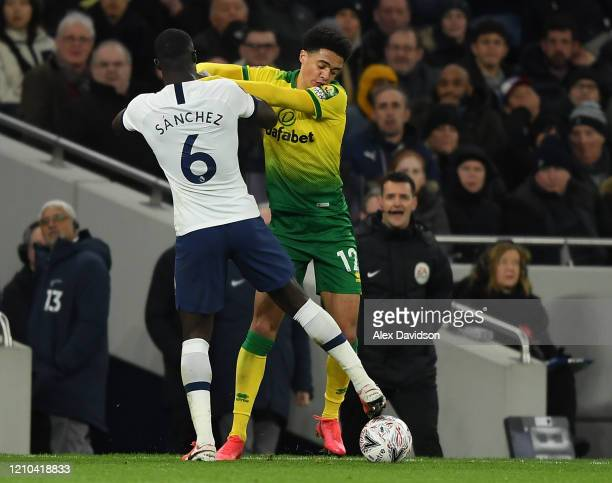 Jamal Lewis of Norwich City as Davinson Sanchez of Tottenham Hotspur battle for possession during the FA Cup Fifth Round match between Tottenham...
