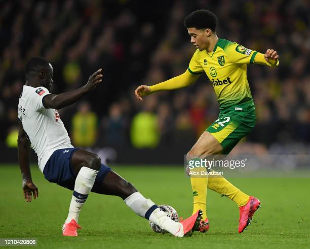Jamal Lewis of Norwich City goes past Davinson Sanchez of Tottenham Hotspur during the FA Cup Fifth Round match between Tottenham Hotspur and Norwich...
