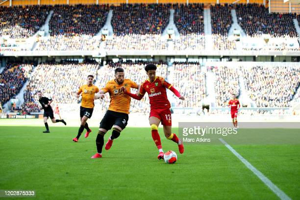 Jamal Lewis of Norwich City in action with Matt Doherty of Wolverhampton Wanderers during the Premier League match between Wolverhampton Wanderers...