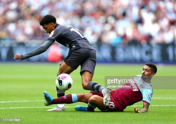 Jamal Lewis of Norwich City is challenged by Manuel Lanzini of West Ham United during the Premier League match between West Ham United and Norwich...
