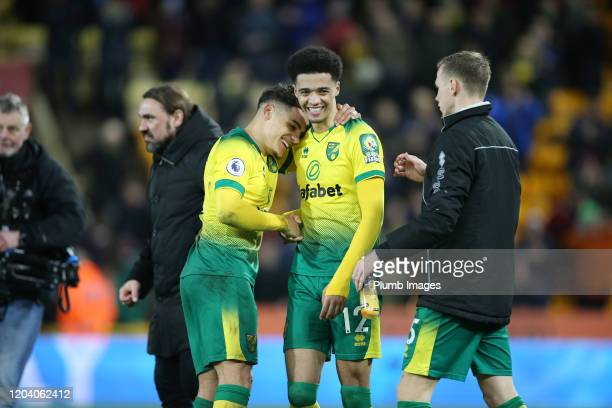 Jamal Lewis of Norwich City , Max Aarons of Norwich City and Ondrej Duda of Norwich City celebrate after the Premier League match between Norwich...