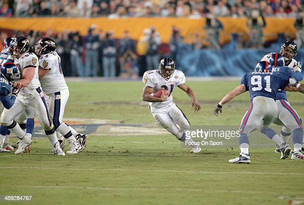 Jamal Lewis of the Baltimore Ravens carries the ball against the New York Giants during Super Bowl XXXV at Raymond James Stadium January 28 2001 in...