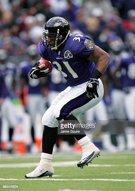 Jamal Lewis of the Baltimore Ravens carries the ball during the game against the Houston Texans on December 4 2005 at MT Bank Stadium in Baltimore...