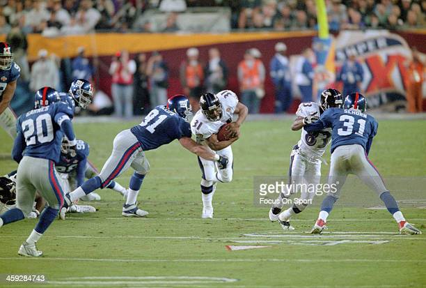 Jamal Lewis of the Baltimore Ravens gets hit by Ryan Phillips of the New York Giants during Super Bowl XXXV at Raymond James Stadium January 28 2001...