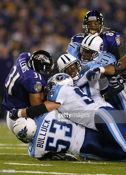 Jamal Lewis of the Baltimore Ravens is gang tackled by the Tennessee Titans during their AFC WildCard playoff game at M T Bank Stadium on January 3...