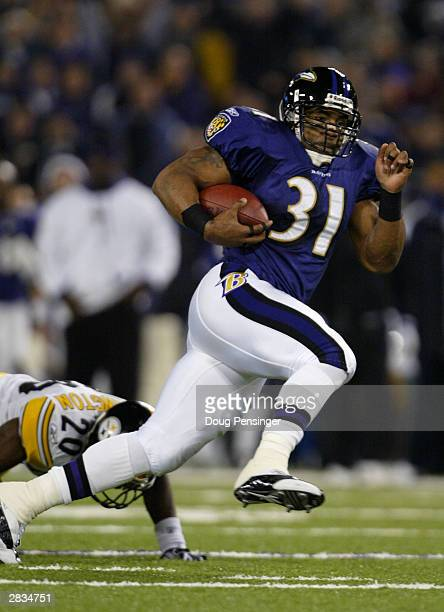Jamal Lewis of the Baltimore Ravens leaves Dewayne Washington of the Pittsburgh Steelers in his wake as he goes 26 yards for a first quarter...