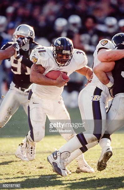 Jamal Lewis of the Baltimore Ravens plays in the AFC Championship Game game against the Oakland Raiders on January 14 2001 at the OaklandAlameda...