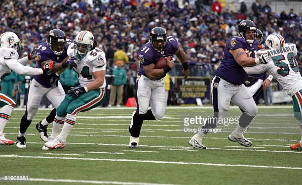 Jamal Lewis of the Baltimore Ravens runs for a gain of 11 yards during the Ravens game against the Miami Dolphins during second quarter NFL action at...