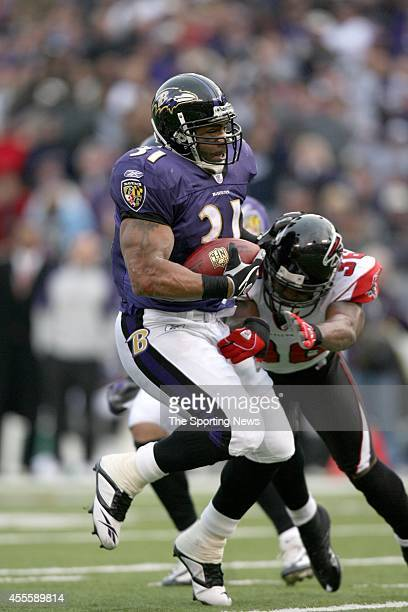 Jamal Lewis of the Baltimore Ravens runs through the tackle by Lawyer Milloy of the Atlanta Falcons during a game on November 19 2006 at the MT Bank...