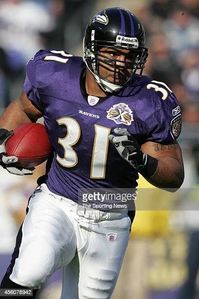 Jamal Lewis of the Baltimore Ravens runs with the ball during a game against the Houston Texans on December 4 2005 at the MT Bank Stadium in...