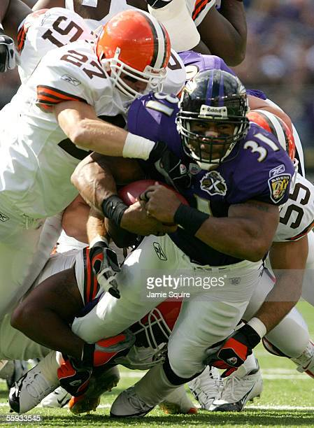 Jamal Lewis of the Baltimore Ravenscarries the ball against the Cleveland Browns during the first half October 16, 2005 at M&T Bank Stadium in...