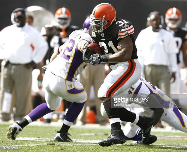 Jamal Lewis of the Cleveland Browns runs by Chad Greenway of the Minnesota Vikings at Cleveland Browns Stadium on September 13 2009 in Cleveland Ohio