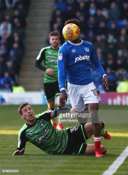 Jamal Lowe of Portsmouth and Gary Sawyer of Plymouth Argyle battle for possession during the Sky Bet League One match between Portsmouth and Plymouth...
