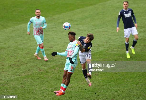 Jamal Lowe of Swansea City and Dan McNamara of Millwall FC battle for the ball during the Sky Bet Championship match between Millwall and Swansea...