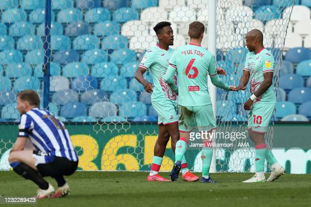 Jamal Lowe of Swansea City celebrates after scoring a goal to make it 0-1 with Jay Fulton and Andre Ayew during the Sky Bet Championship match...
