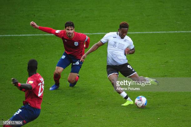 Jamal Lowe of Swansea City has a shot during the Sky Bet Championship match between Swansea City and Huddersfield Town at the Liberty Stadium on...