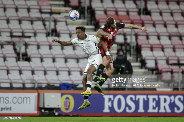 Jamal Lowe of Swansea City with Jack Wilshere of Bournemouth during the Sky Bet Championship match between AFC Bournemouth and Swansea City at...