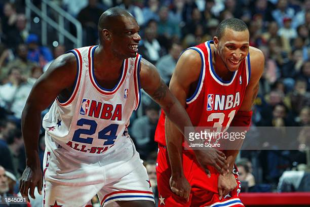Jamal Mashburn of the Eastern Conference All-Stars jokes with Shawn Marion of the Western Conference All-Stars at the 2003 NBA All-Star Game on...