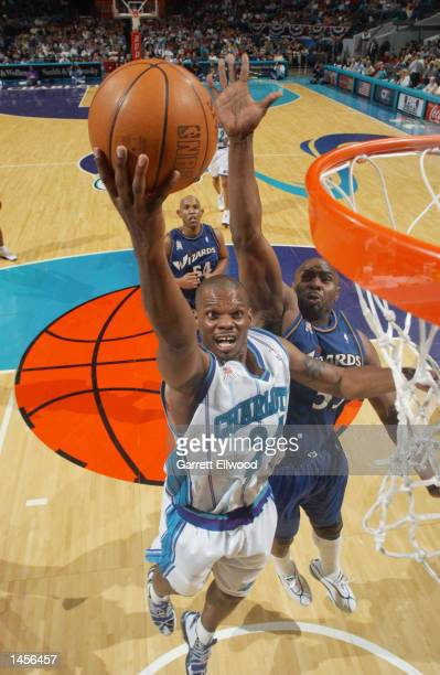Jamal Mashburn of the Charlotte Hornets goes to the basket against the Washington Wizards at the Charlotte Coliseum in Charlotte, North Carolina....