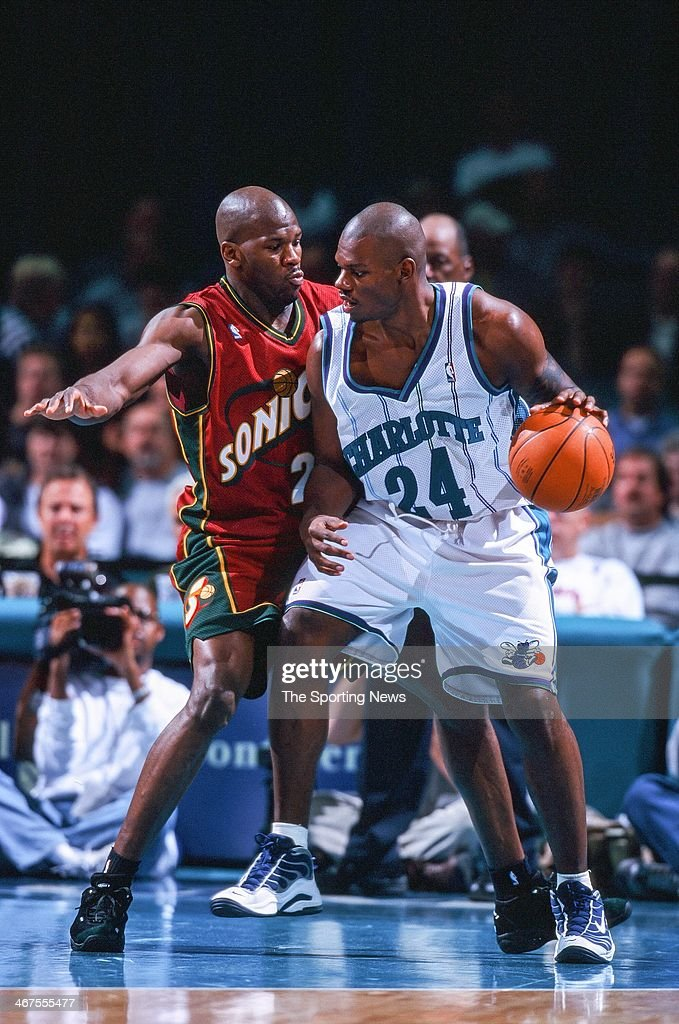 Jamal Mashburn of the Charlotte Hornets moves the ball against Ruben Patterson of the Seattle Supersonics during the game on November 9, 2000 at Charlotte Coliseum in Charlotte, North Carolina.